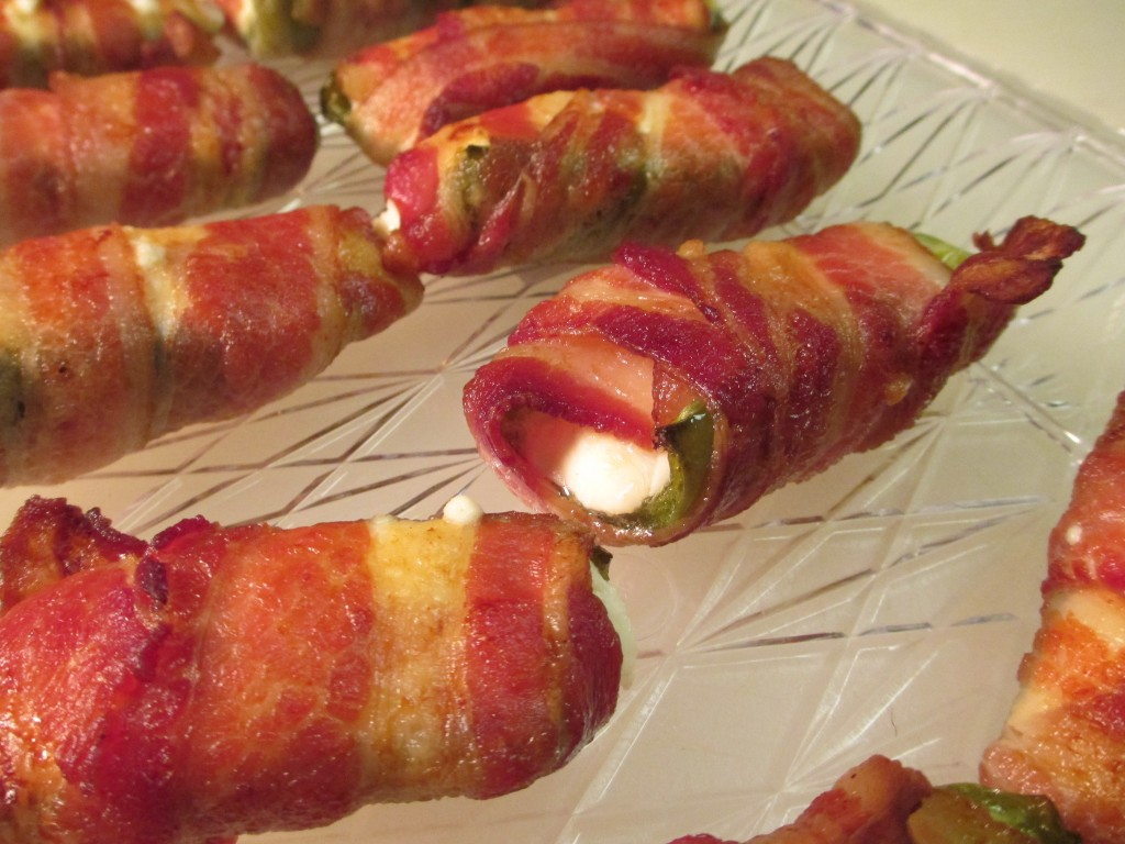 bacon wrapped stuffed jalapeno peppers make for the perfect game-day appetizer.