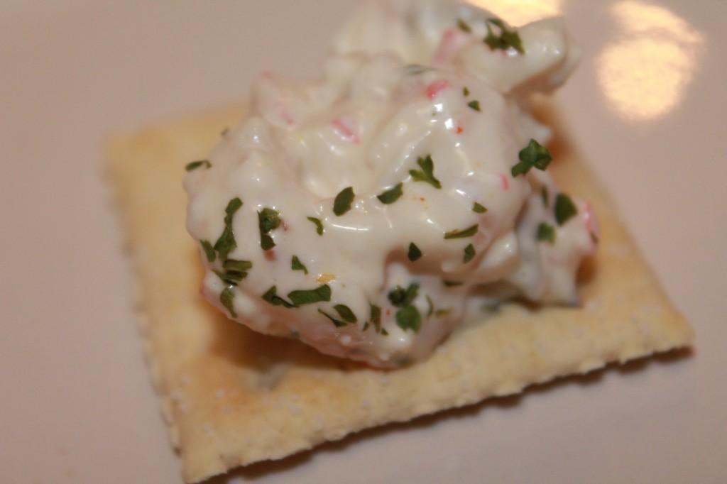 Creamy seafood salad on a saltine