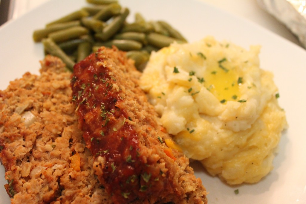 Cheesy garlic mashed potatoes make for the ultimate addition to any comfort food meal, like a baked meatloaf.