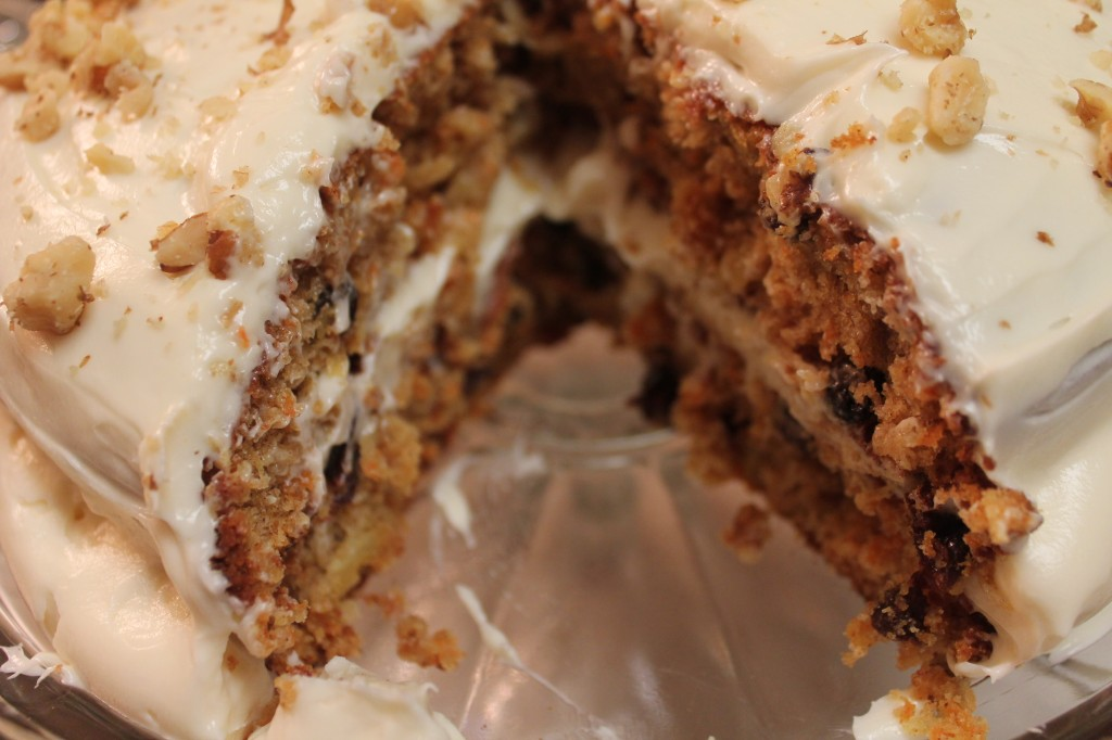 Raisins and walnuts are scattered through this delicious carrot cake.