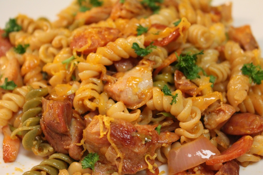 Tender grilled cajun chicken tossed with smoked sausage, onions, garlic, and pasta!