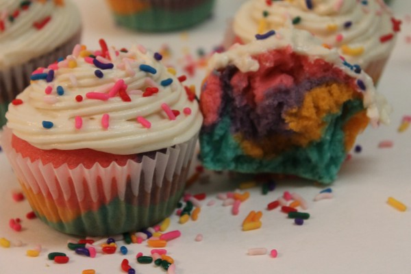 These cute rainbow cupcakes with vanilla frosting and sprinkles are a perfect birthday party treat