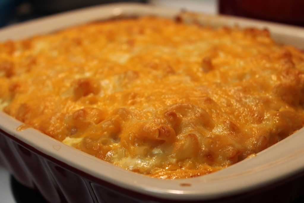 Southern Baked Mac and Cheese has a rich crust on top that hides the creamy cheese sauce underneath.