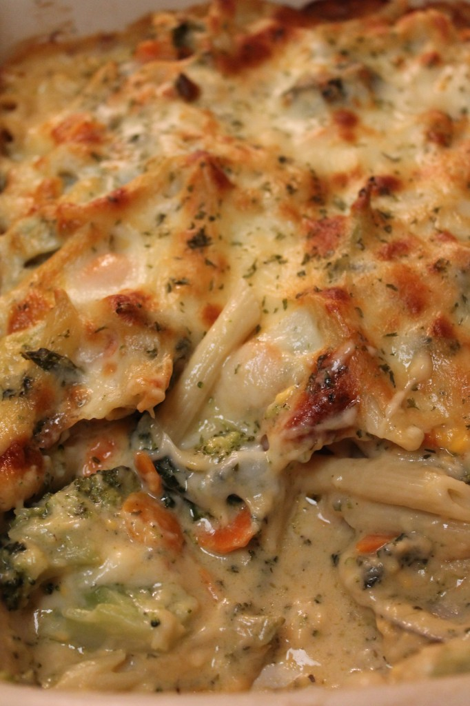This baked ziti is meatless and made with a creamy cheese sauce, pasta, and vegetables like broccoli and carrots