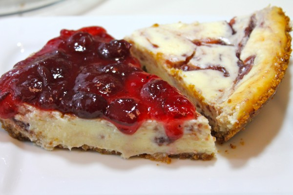 Homemade white chocolate cheesecake with a sweet cranberry sauce