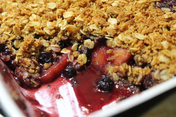 Sweet blueberry and peach cobbler with a crispy crumble topping