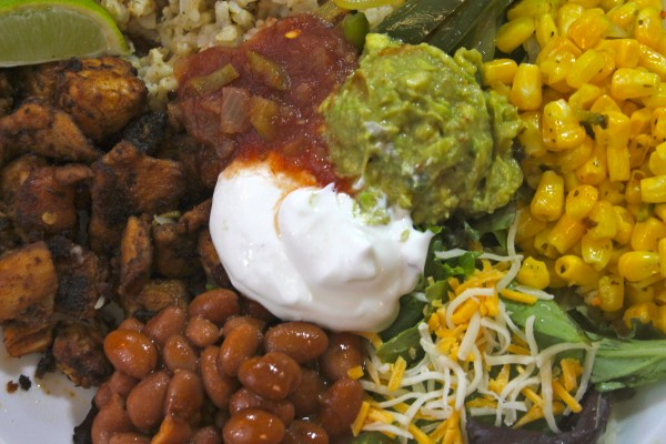 Assemble your chicken burrito bowl with all the fixing and enjoy! A little bit of everything makes this one delicious creation.