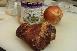 Gather the ham bones, garlic and onions.