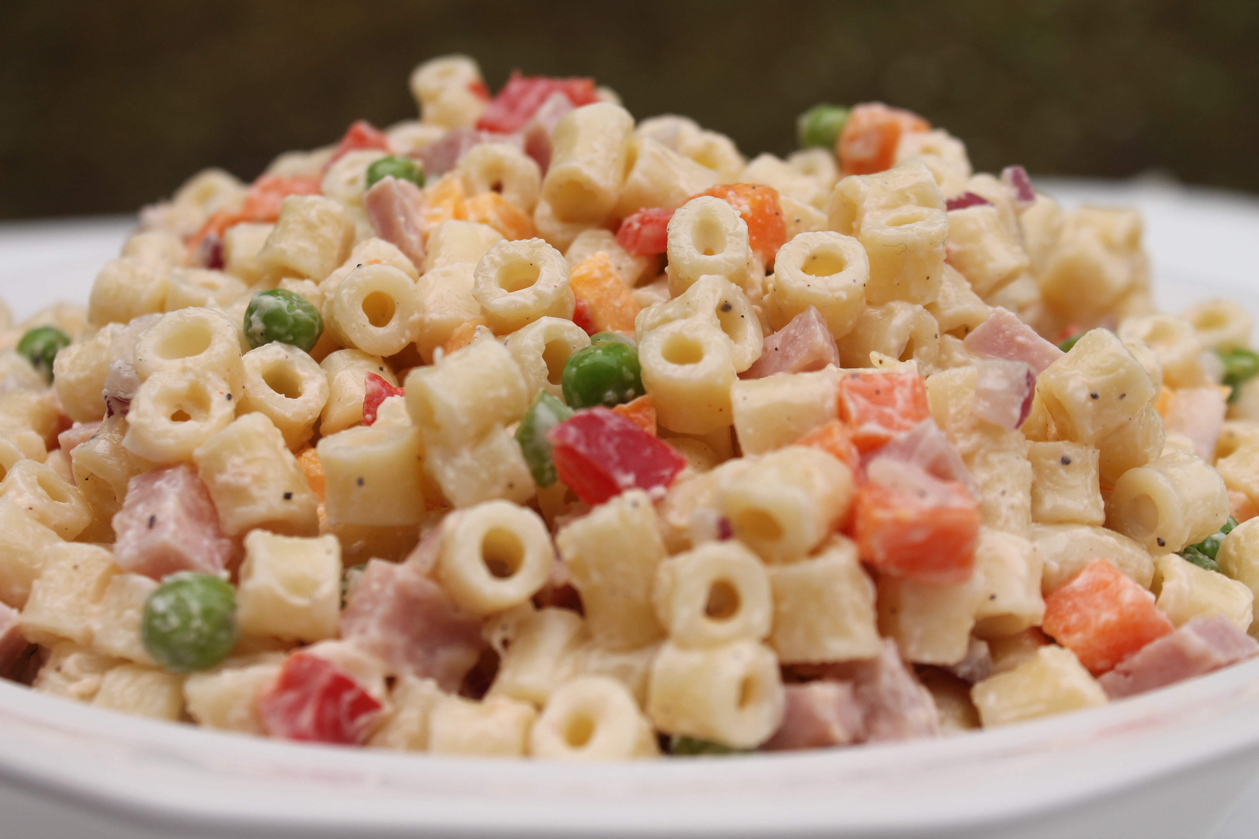 Creamy Pasta Salad loaded with vegetables, ham and cheese.