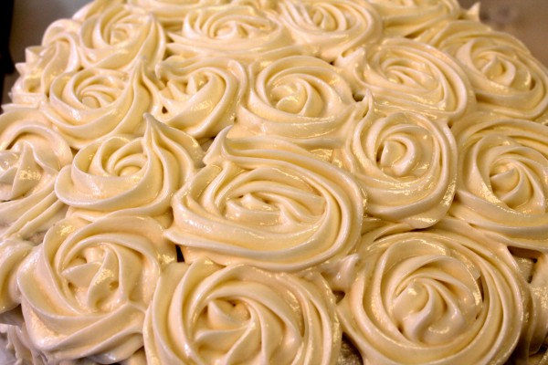 Cream cheese dressing made into rose swirls