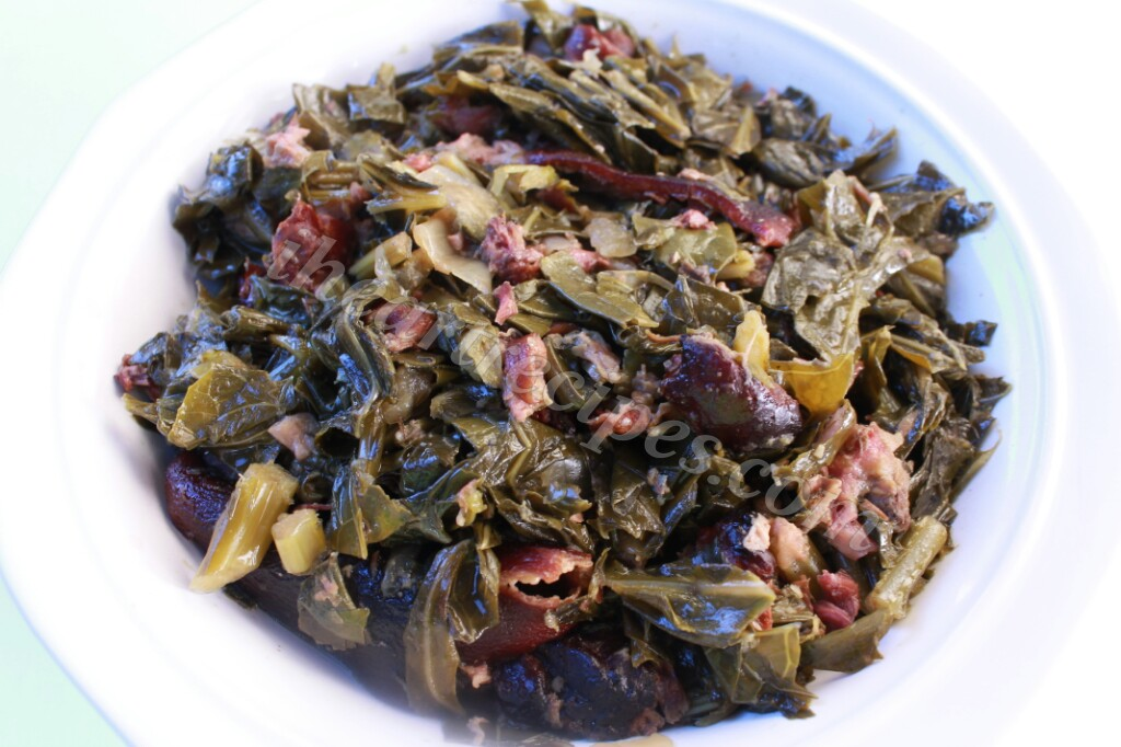 These tender slow cooked collard greens are prepared in a slow cooker with ham hocks to impart deep smoky flavor.