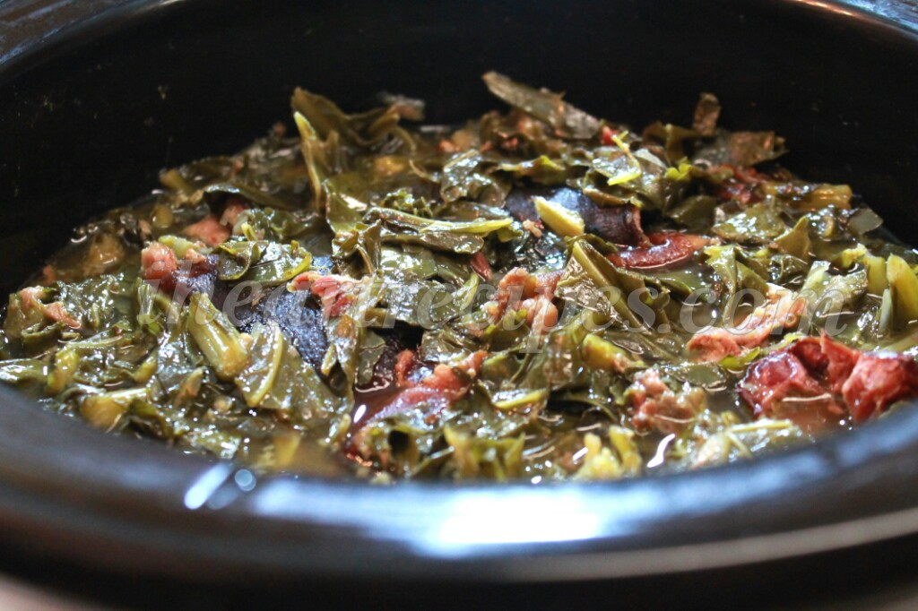 Cooking collard greens in a crock pot allows for no-mess and no-fuss cooking.