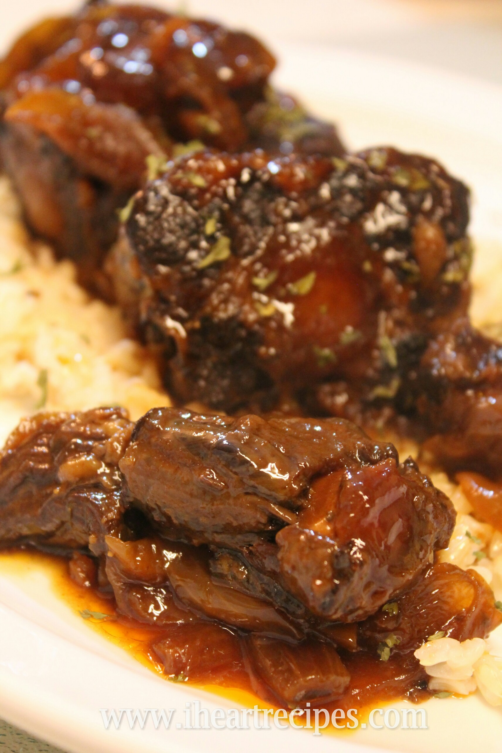 These tender oxtails are slow cooked with a sweet and spicy BBQ sauce