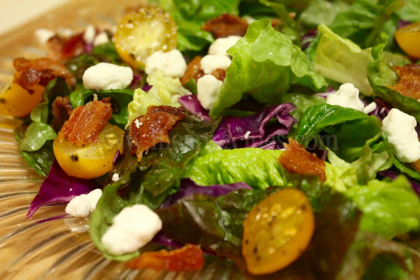 This bacon and goat cheese spring salad can be topped with anything you'd like, from tomatoes to croutons or walnuts