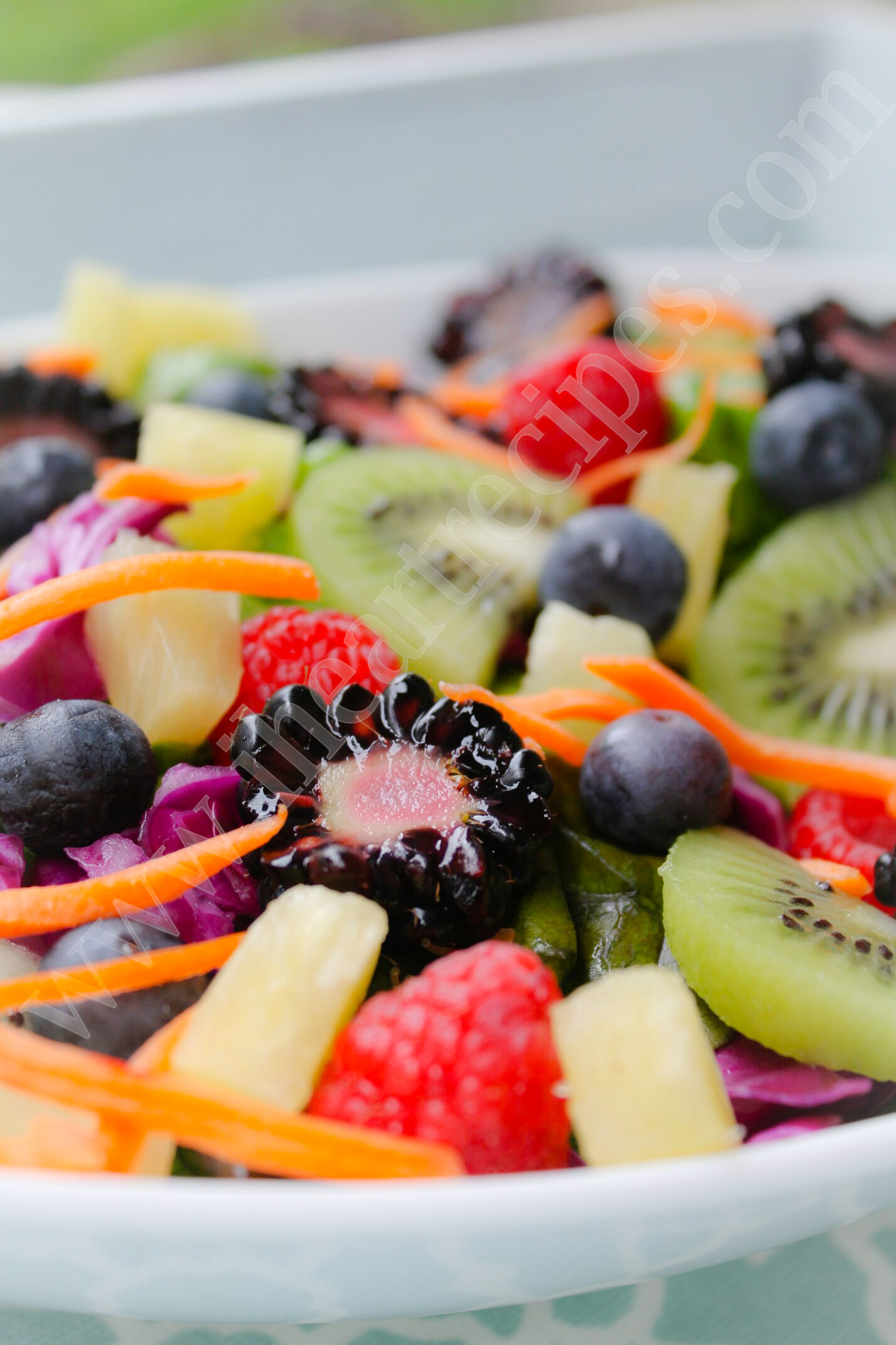 Juicy fresh blackberries, strawberries and pineapple freshen up this delicious spring salad