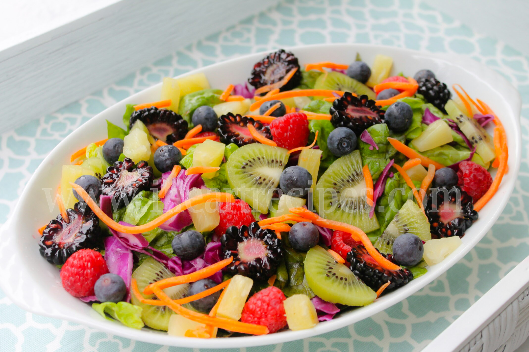 Nothing says spring quite like this fresh paradise spring salad with tons of fresh fruit