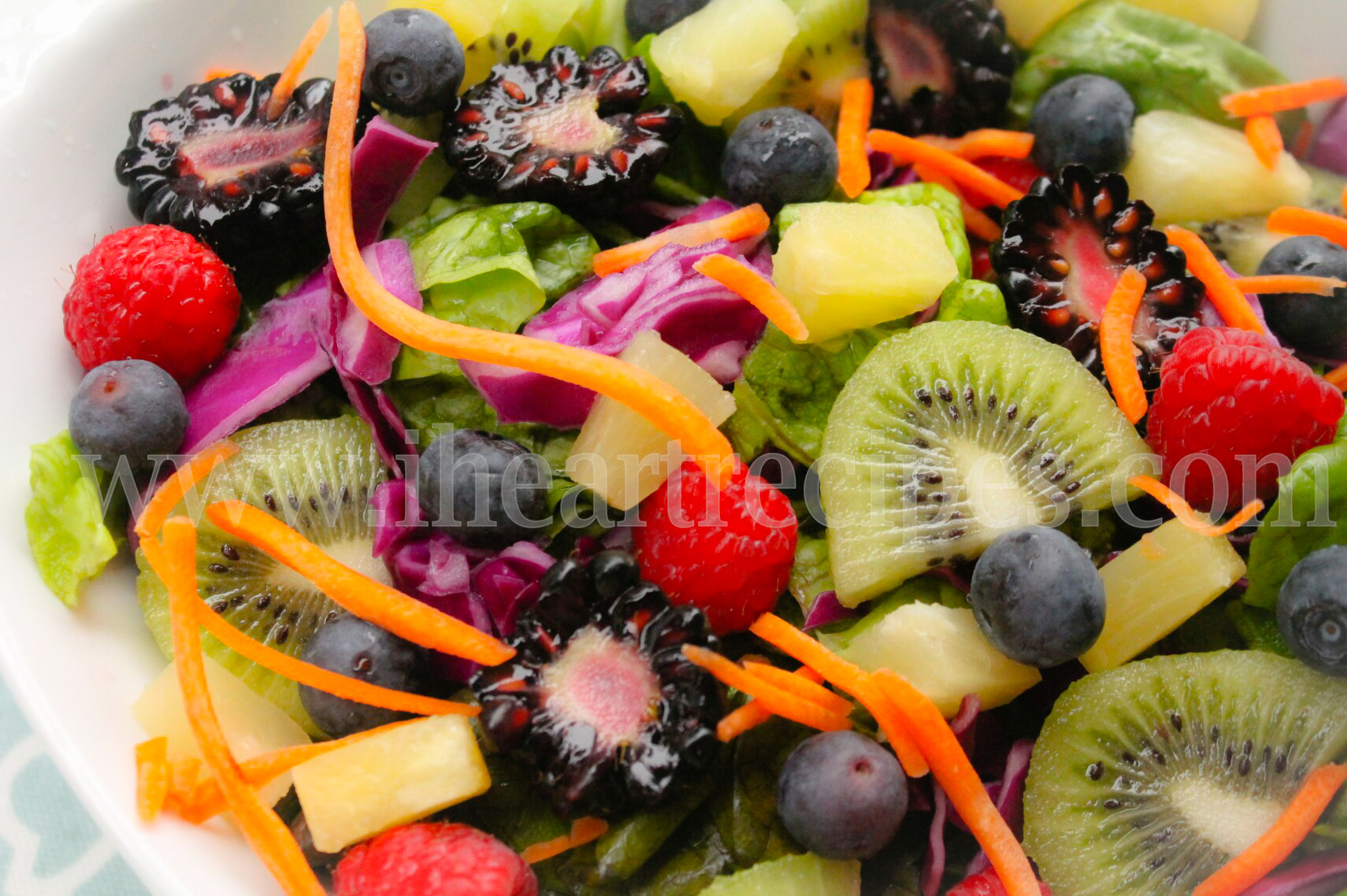 Sweet kiwi, raspberries, blackberries and blueberries make this paradise spring salad a fresh treat