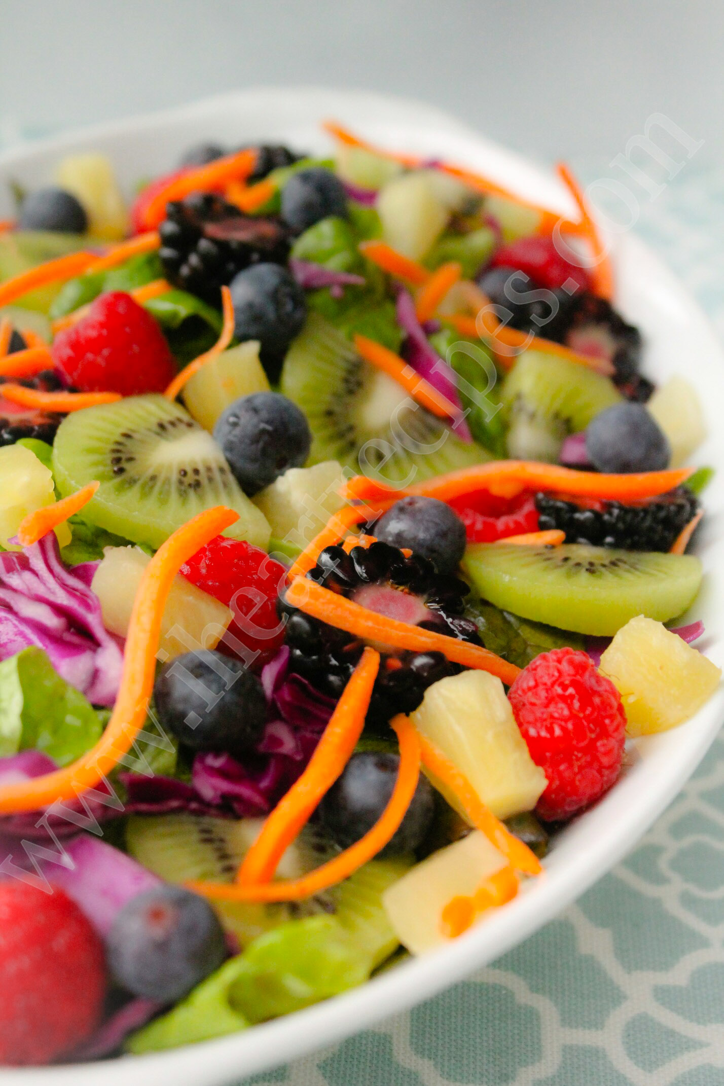 This delicious fresh fruit salad served over a bed of red cabbage and crispy lettuce is a spring treat