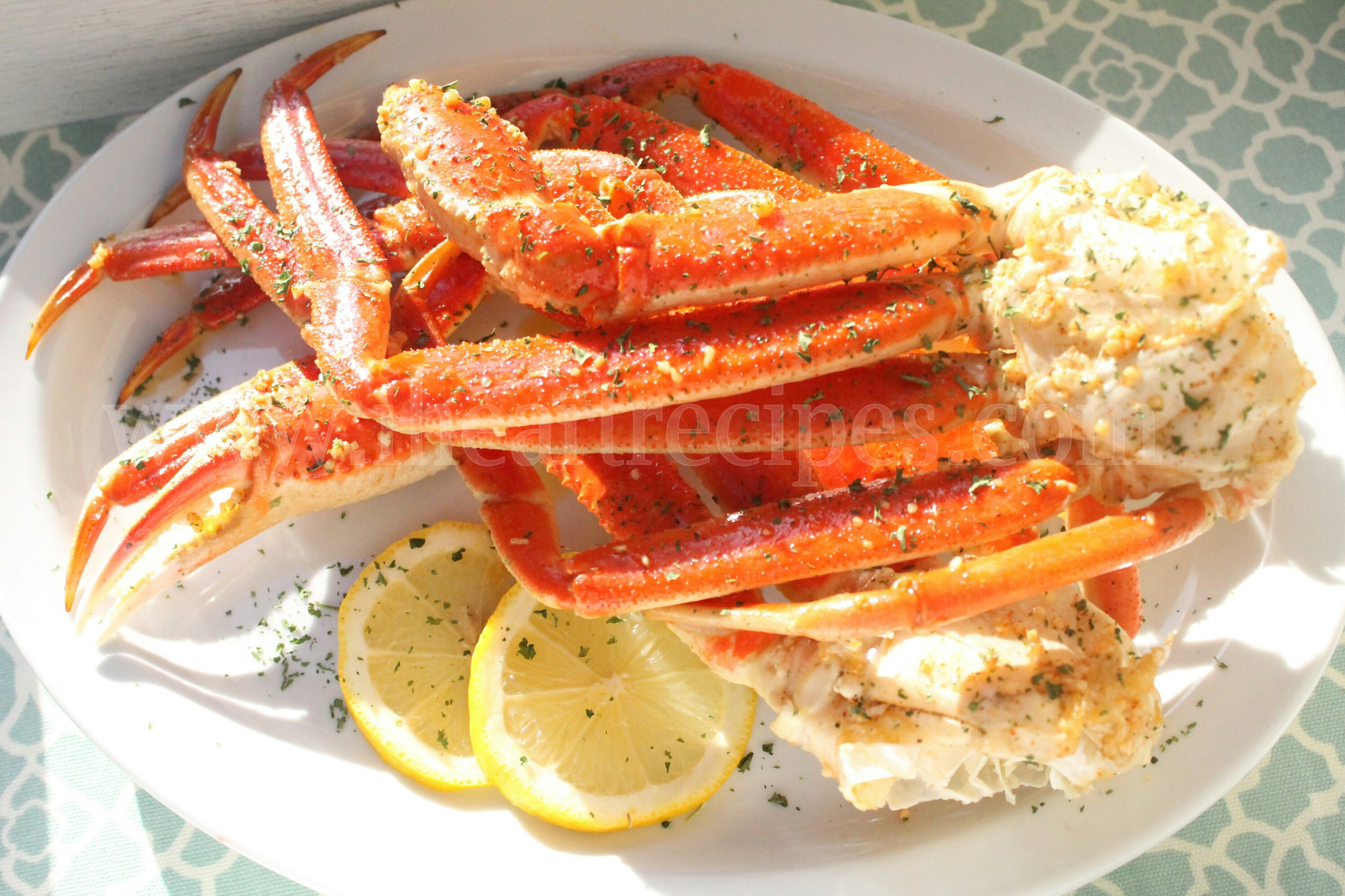 This super easy crab legs recipe is made in the oven, with tons of delicious butter, garlic, and lemon.
