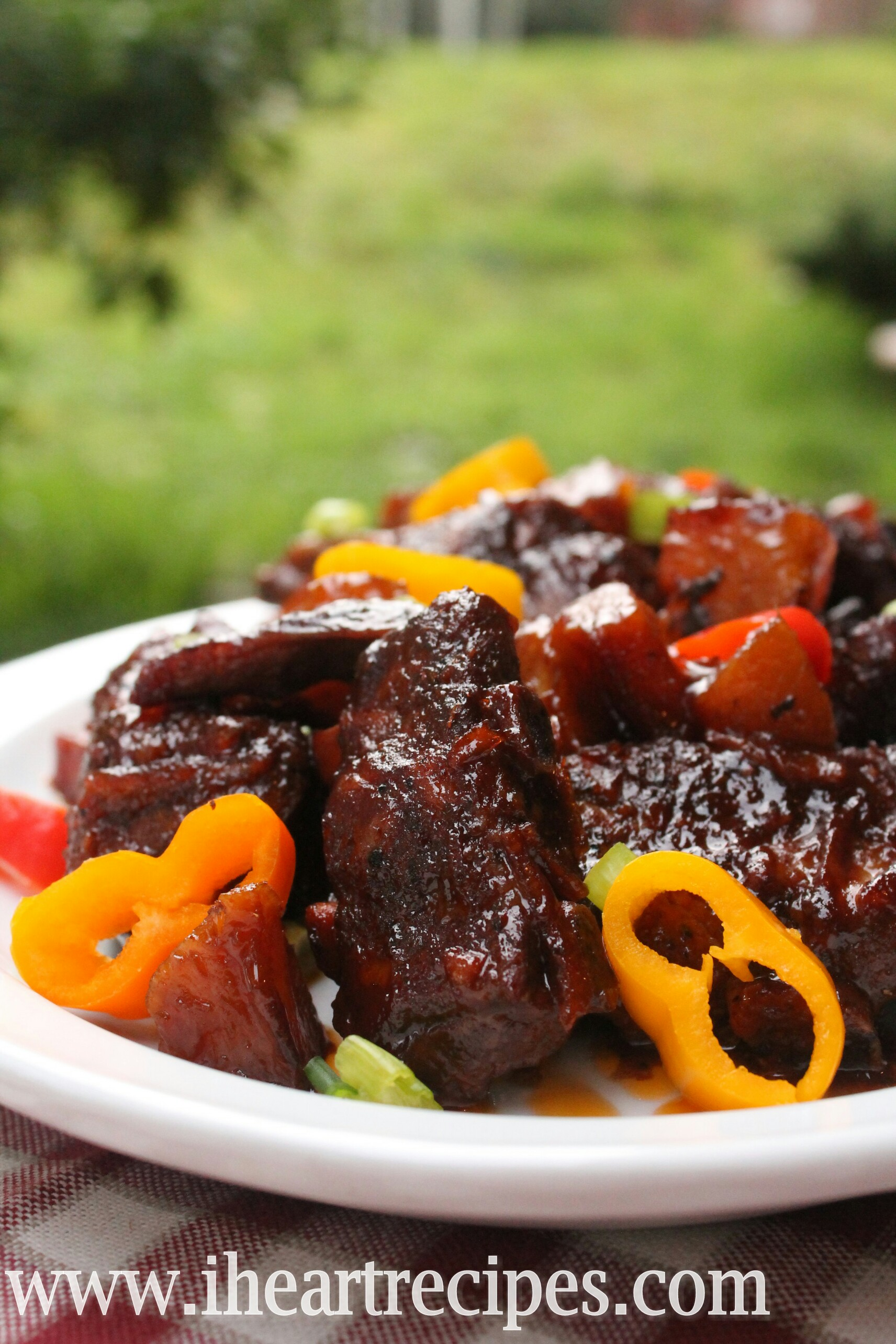 Tender pork short ribs and a sweet and tangy BBQ sauce make this slow cooked dish a perfect summertime meal