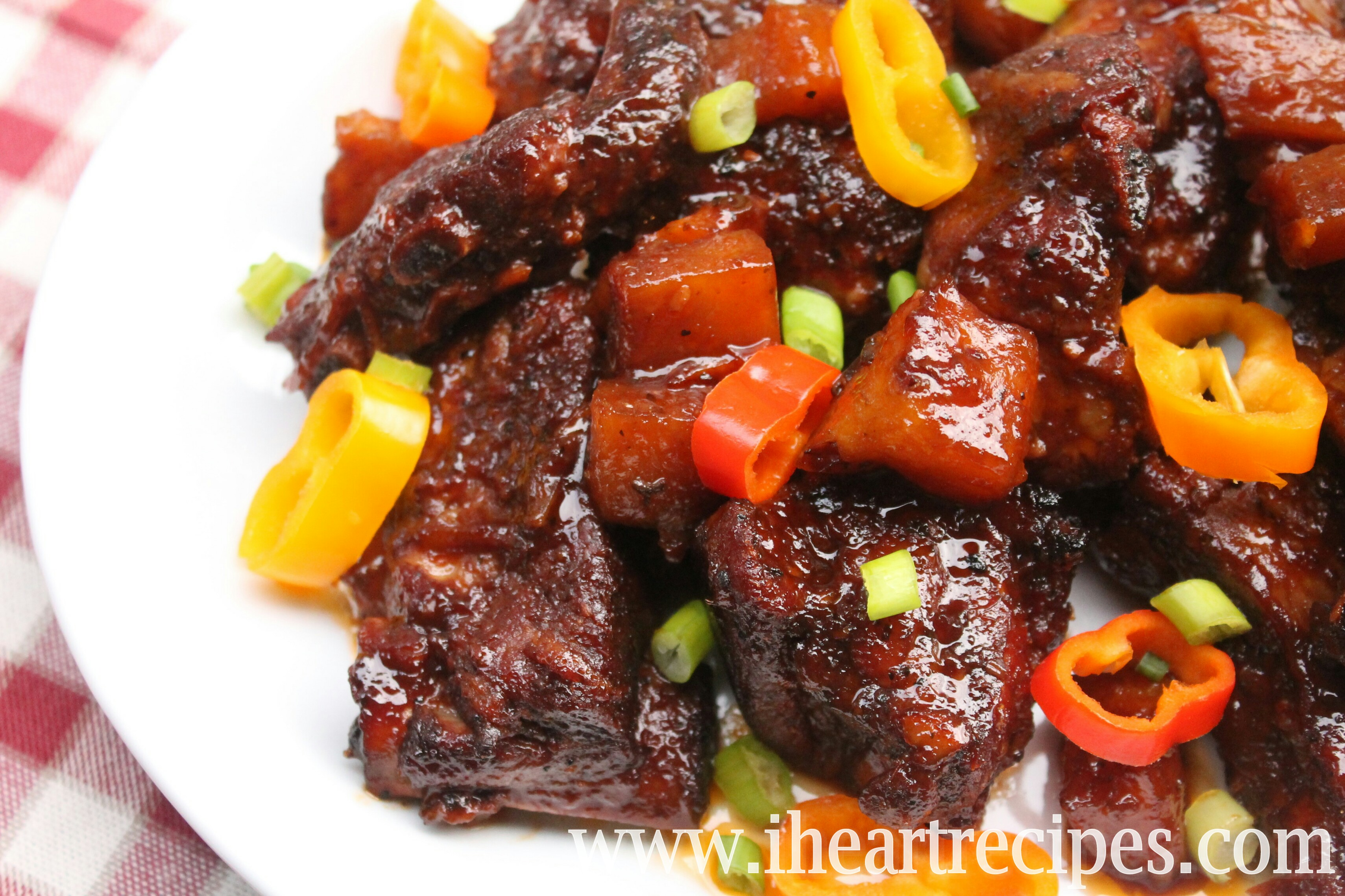These sweet and smokey pork spare ribs are cooked to tender perfection