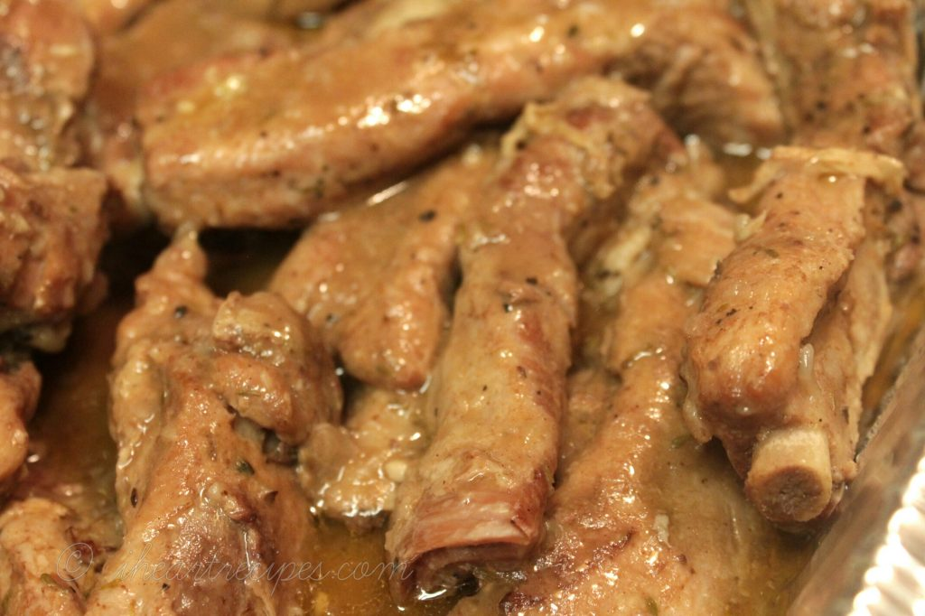 Homemade ribs smothered in garlic and onion gravy