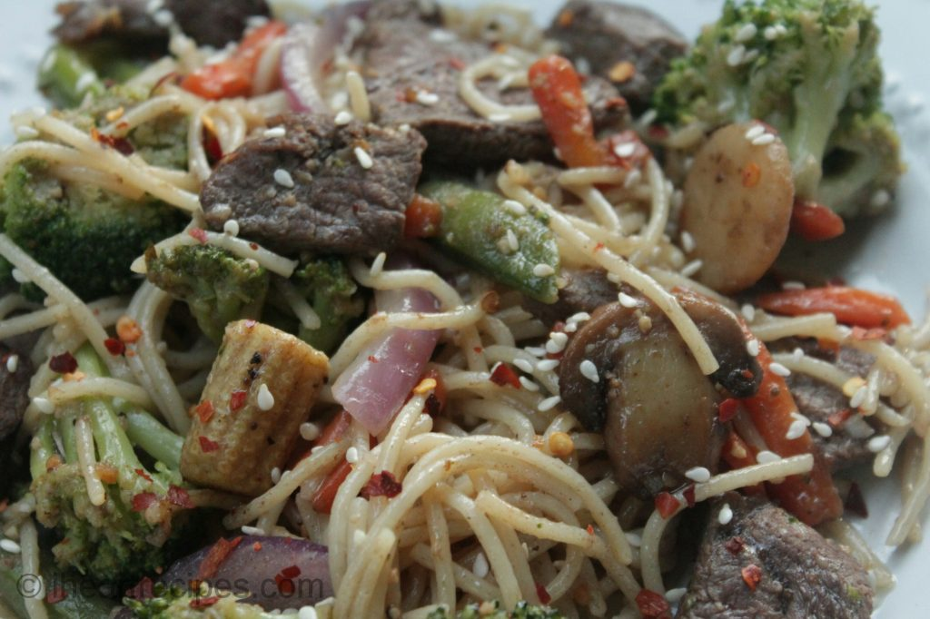 Customize this delicious beef and spaghetti stir fry with all the vegetables you like