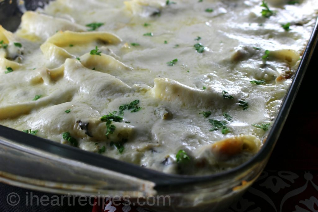 This turkey and collard greens stuffed shells in a casserole dish is so flavorful.