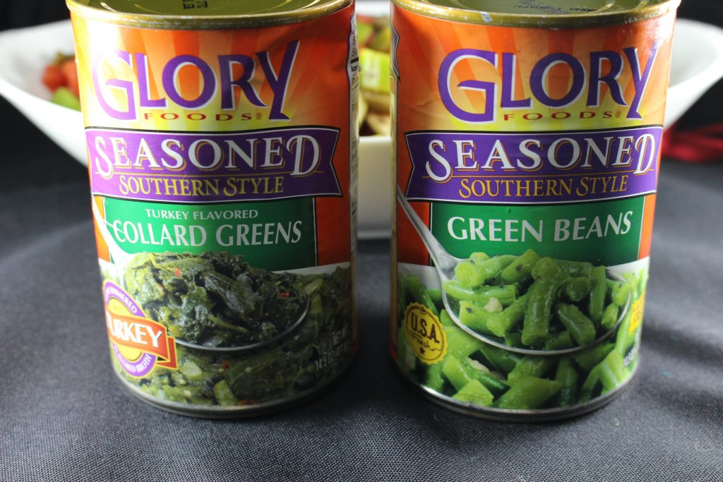 A can of of Glory Foods seasoned southern style turkey flavored collard greens and a can of of Glory Foods seasoned southern style green beans.