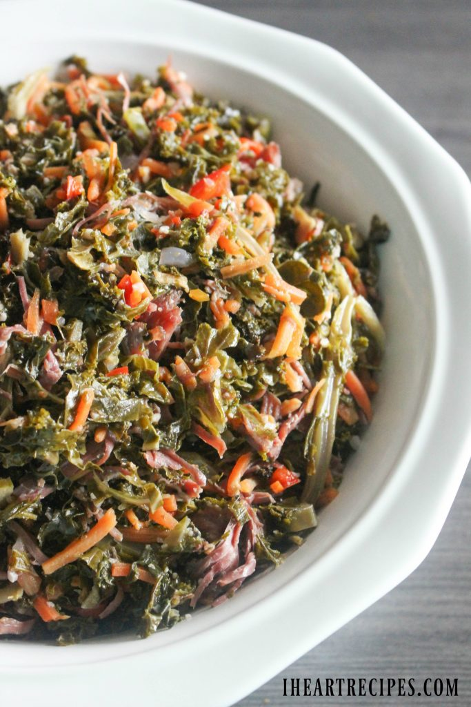Packed with veggies and crispy bacon, this braised kale is a delicious southern side dish