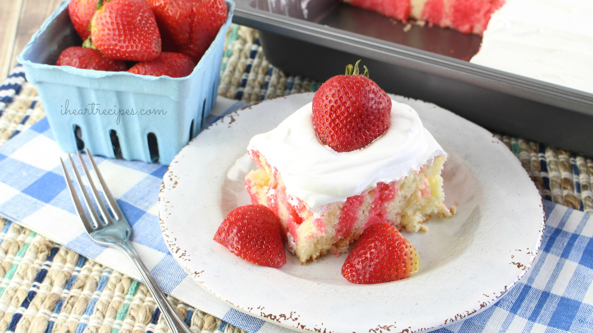 This sweet summer strawberry poke cake is made with fresh strawberries and sweet whipped cream