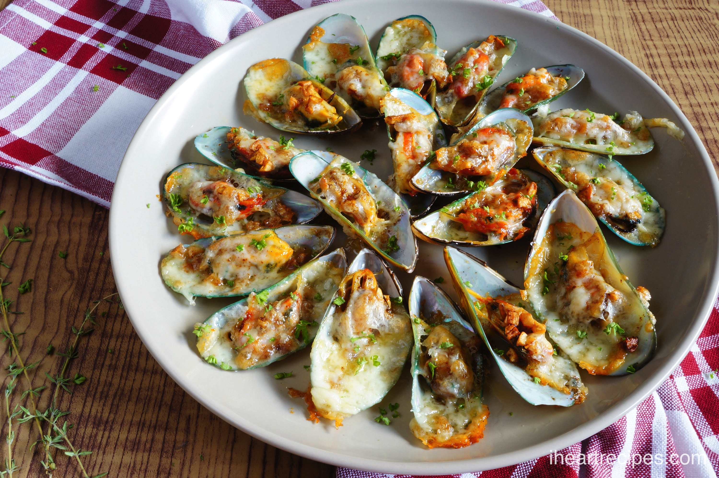 The garlicky butter sauce on these Cheesy Garlic Mussels is divine!