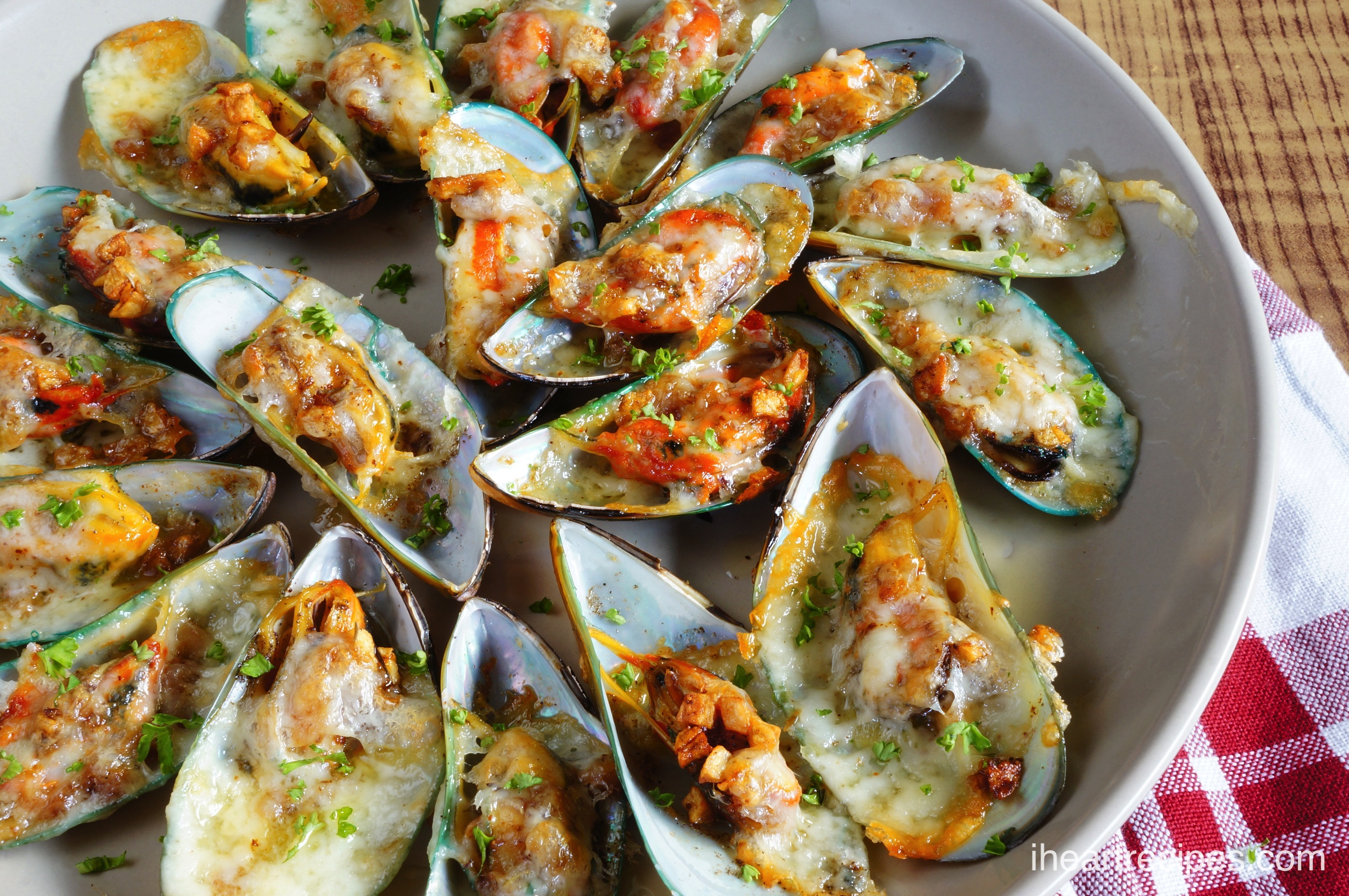 These Cheesy Garlic Mussels are baked, not steamed! So delicious.