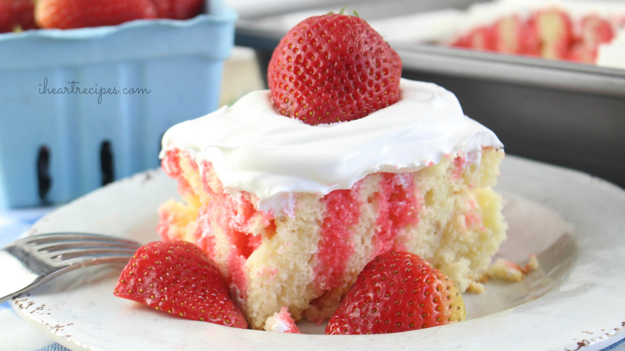 Topped with a sweet whipped cream, this strawberry poke cake is a refreshing treat