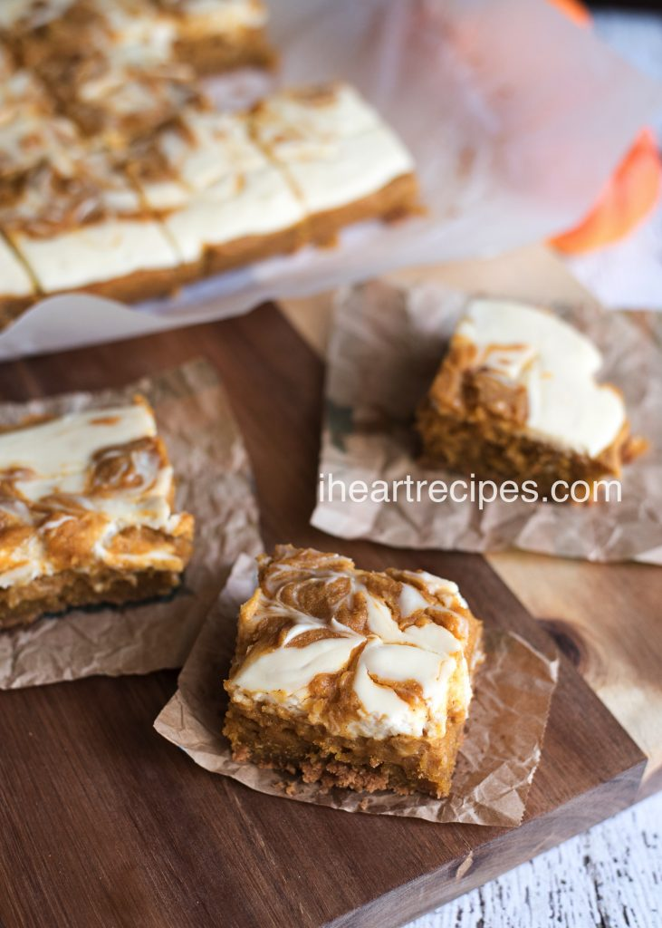 The super creamy pumpkin swirl cheesecake tops these soft pumpkin bars