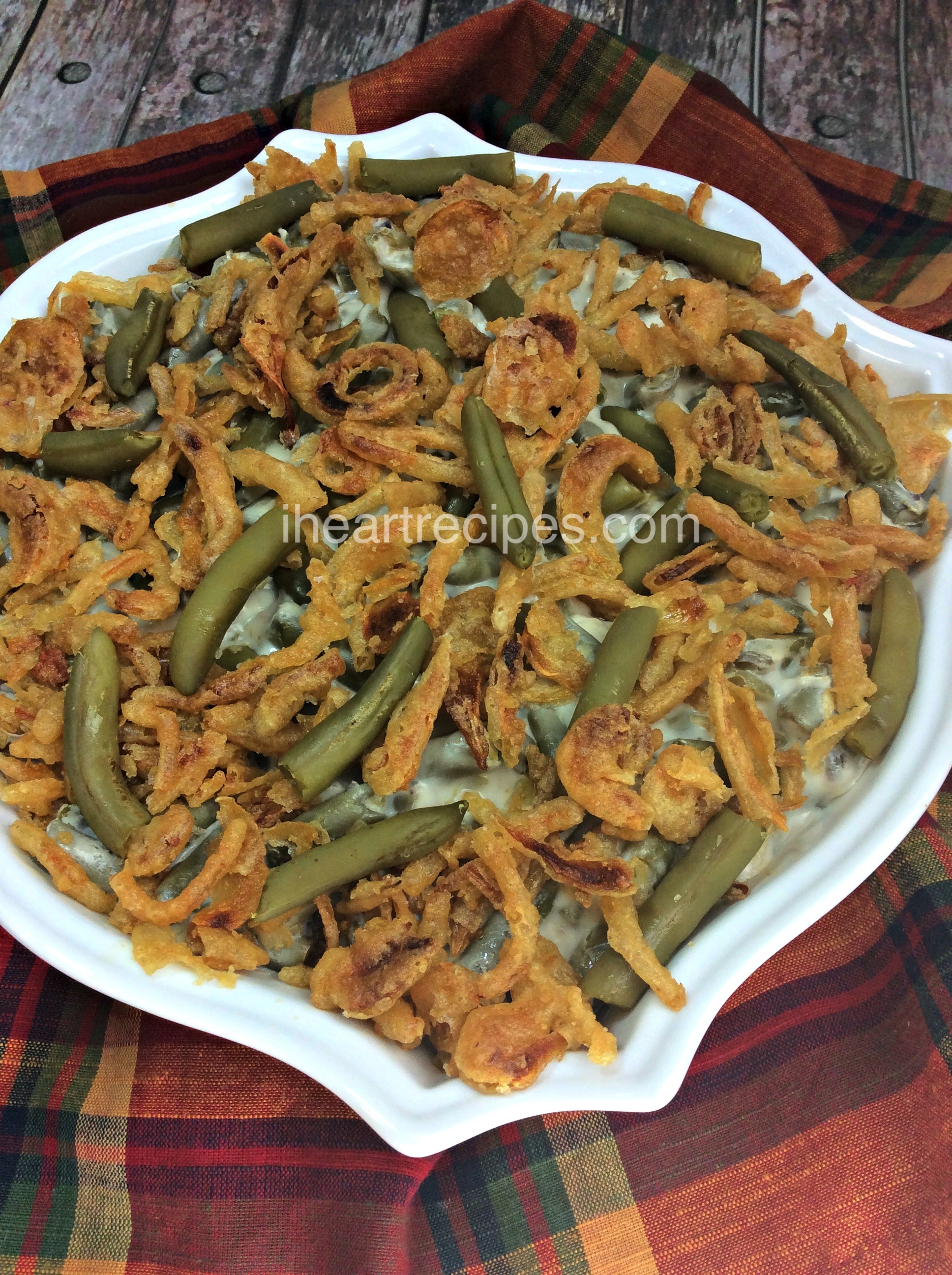 Crispy french fried onions top this creamy green bean casserole with fresh green beans