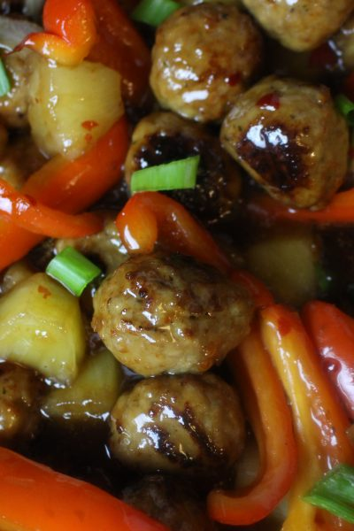 Meatballs with sweet & sour sauce, pineapple chunks, onions, and sweet red peppers.