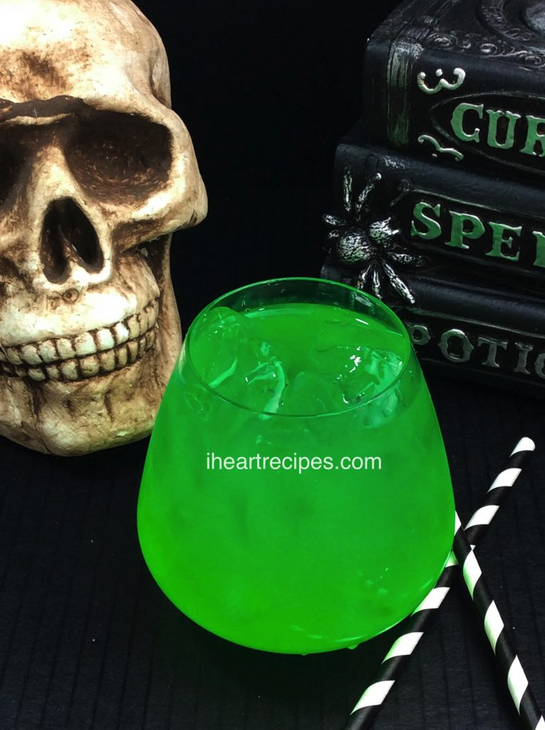 Made with green apple sour pucker, this lime green cocktail is perfect for Halloween