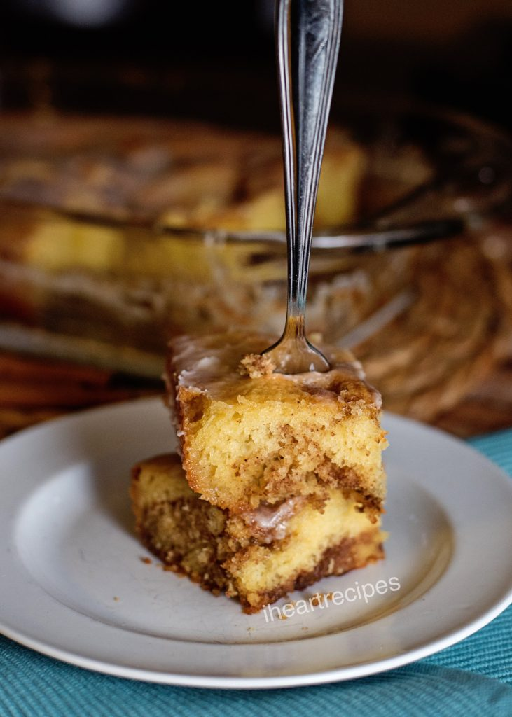 Moist honeybun cake is made with yellow cake swirled with a sweet cinnamon sugar filling