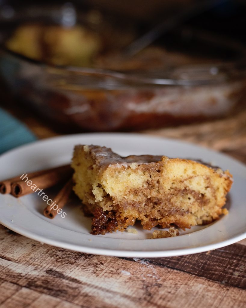 Moist honeybun cake is made with yellow cake mix and a sweet, creamy cinnamon sugar filling