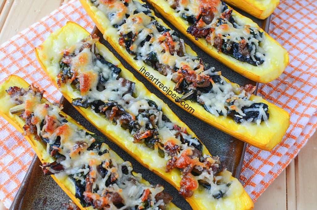 Delicious and tender squash boats with sausage and swiss chard are a hearty, easy meal that's perfect for fall