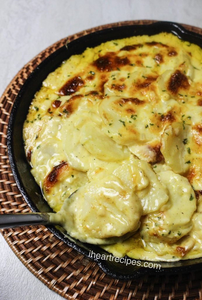 Creamy cheese and tender potatoes in this recipe for cheesy scalloped potatoes make this classic comfort food side dish a must-have at dinner.