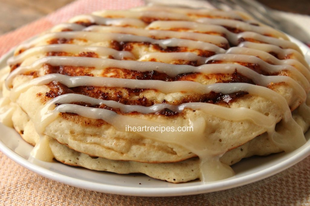 Cinnamon Roll Pancakes with Cream Cheese Icing is a decadent breakfast!