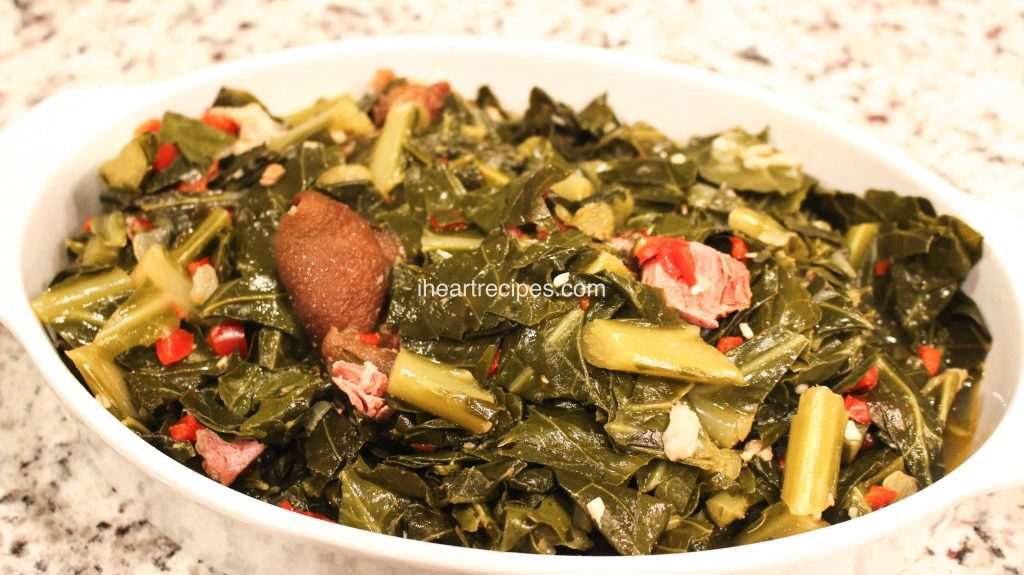 This soul food recipe for collard greens with ham hocks is seasoned to perfection with red peppers, onions, and garlic.