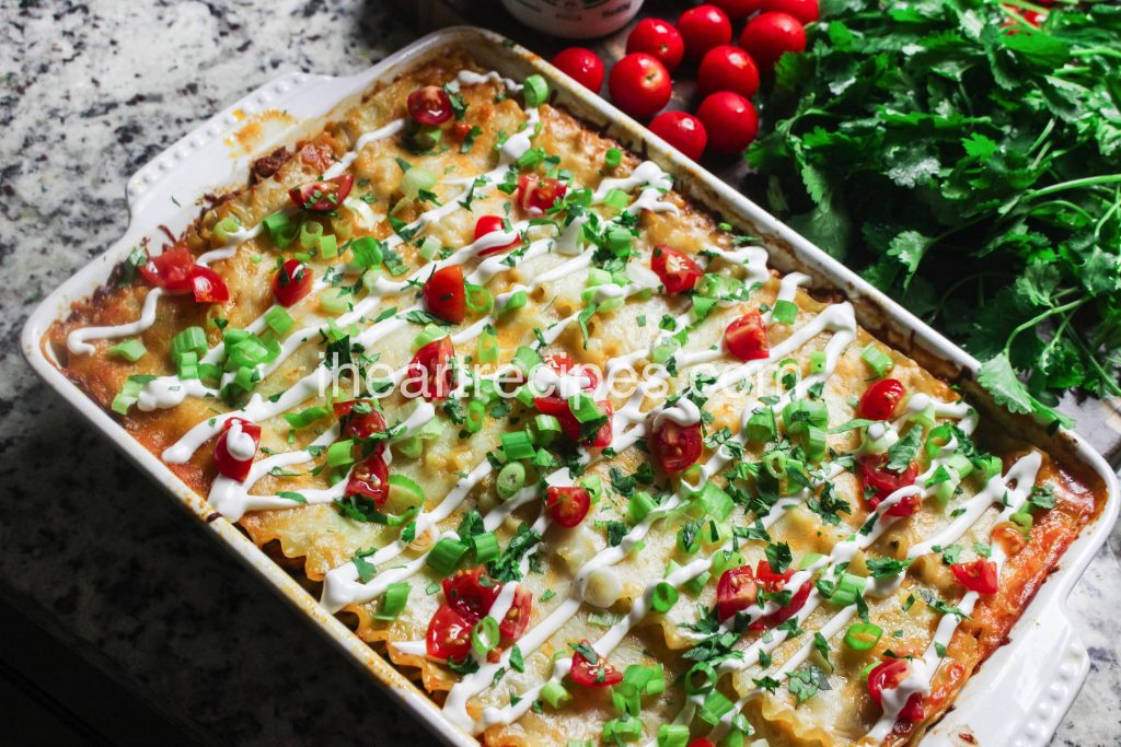 This taco lasagna recipe is made with ground turkey and packed with spices