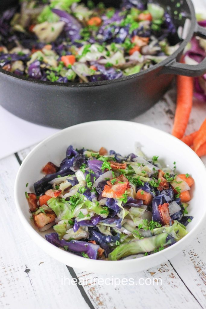 Colorful cabbage stir fried with bacon and cilantro.