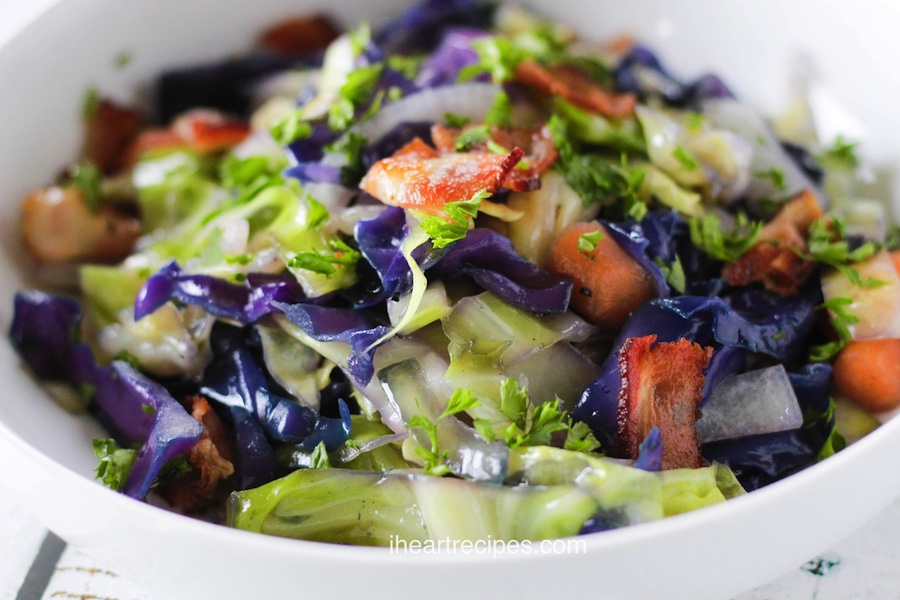 A refreshing cabbage and bacon stir fry with carrots is an easy dinner.