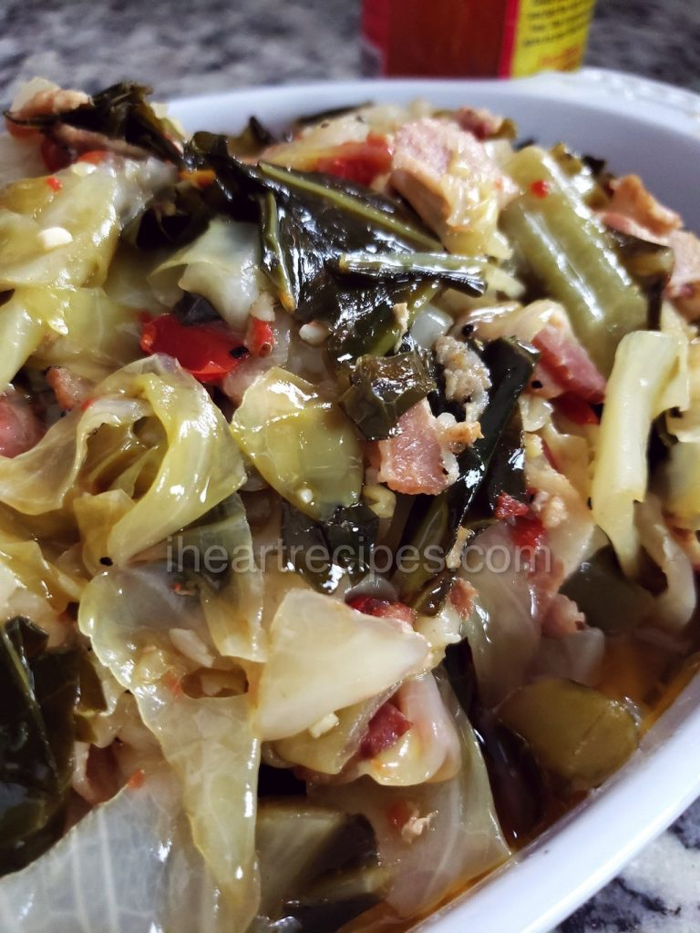 Perfectly cooked collard greens and cabbage with bacon, garlic, and onions