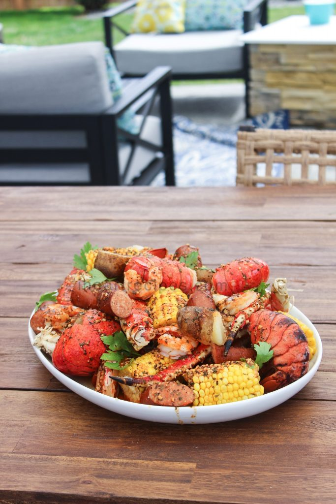 A delicious seafood boil packed with crab legs, lobster tail, sausage and more