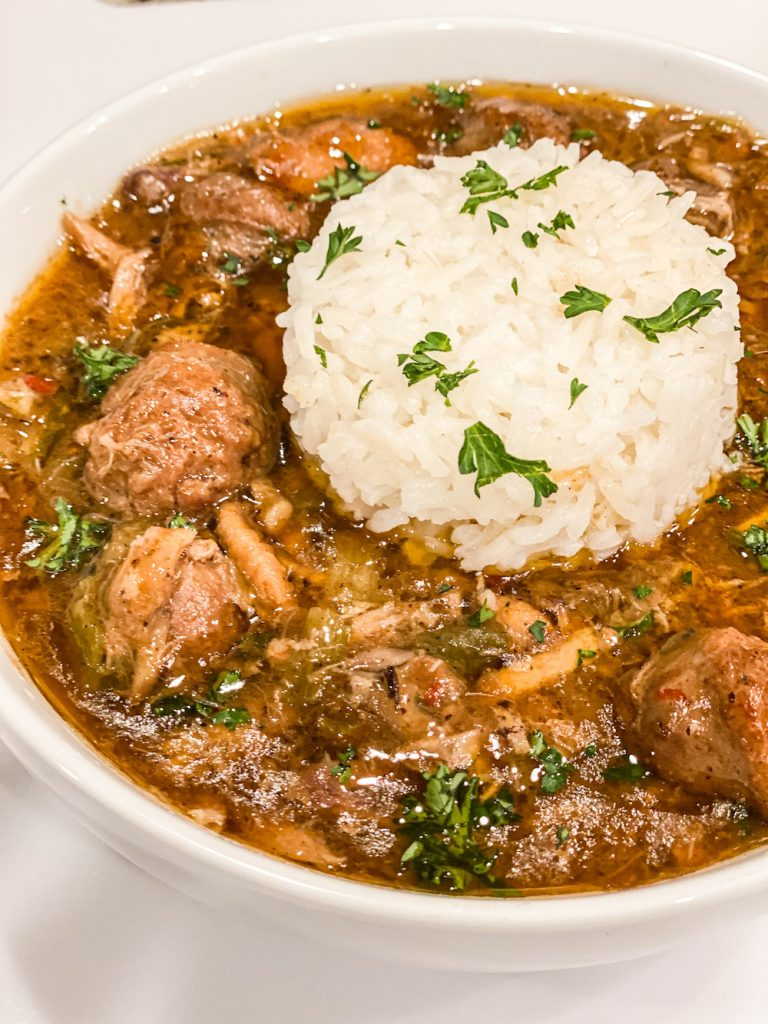 Serve Chicken and Sausage Gumbo with a side of white rice.